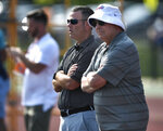 Buffalo Bills general manager Brandon Beane, left, and owner Terry Pegula watch practice at the NFL football team's training camp in Pittsford, N.Y., Thursday, July 25, 2019. (AP Photo/Adrian Kraus)