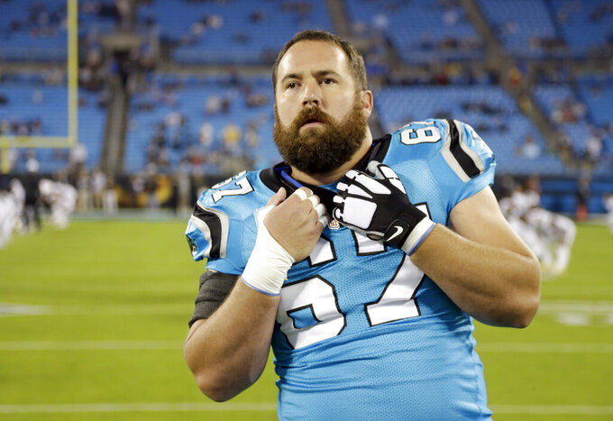 "FILE - In this Thursday, Nov. 17, 2016 file photo, Carolina Panthers' Ryan Kalil (67) stretches before an NFL football game against the New Orleans Saints in Charlotte, N.C. Ryan Kalil has had one whirlwind of a month. From retirement to a new team in a new city with new teammates and coaches in just four weeks. And, now, the New York Jets center is nearly ready to play again. ""I feel like I'm getting my legs back,"" Kalil said Tuesday, Aug. 27, 2019. (AP Photo/Bob Leverone, File)"
