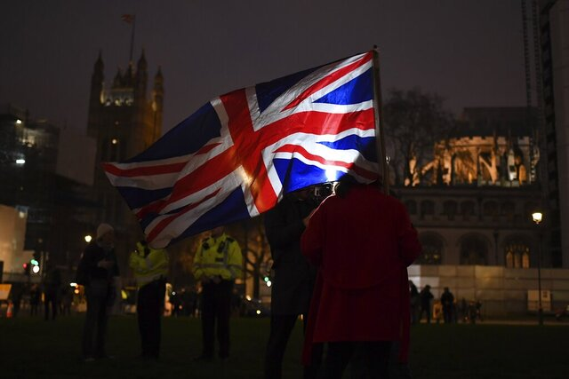 Brexit supporters gather during a rally at the Parliament square in London, Friday, Jan. 31, 2020. Britain officially leaves the European Union on Friday after a debilitating political period that has bitterly divided the nation since the 2016 Brexit referendum. (AP Photo/(AP Photo/Alberto Pezzali)