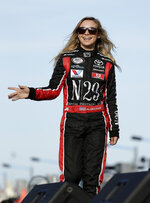 Pole sitter Natalie Decker waves to fans during driver introductions before the start of the ARCA auto race at Daytona International Speedway, Saturday, Feb. 10, 2018, in Daytona Beach, Fla. (AP Photo/Terry Renna)