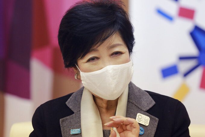 "Tokyo Gov. Yuriko Koike speaks during an interview with The Associated Press in Tokyo, Monday, Dec. 14, 2020. The growing availability of coronavirus vaccines is a ""ray of hope"" for hosting the Olympics next summer, Koike said Monday as Japan struggles with a new surge in infections. (AP Photo/Koji Sasahara)"