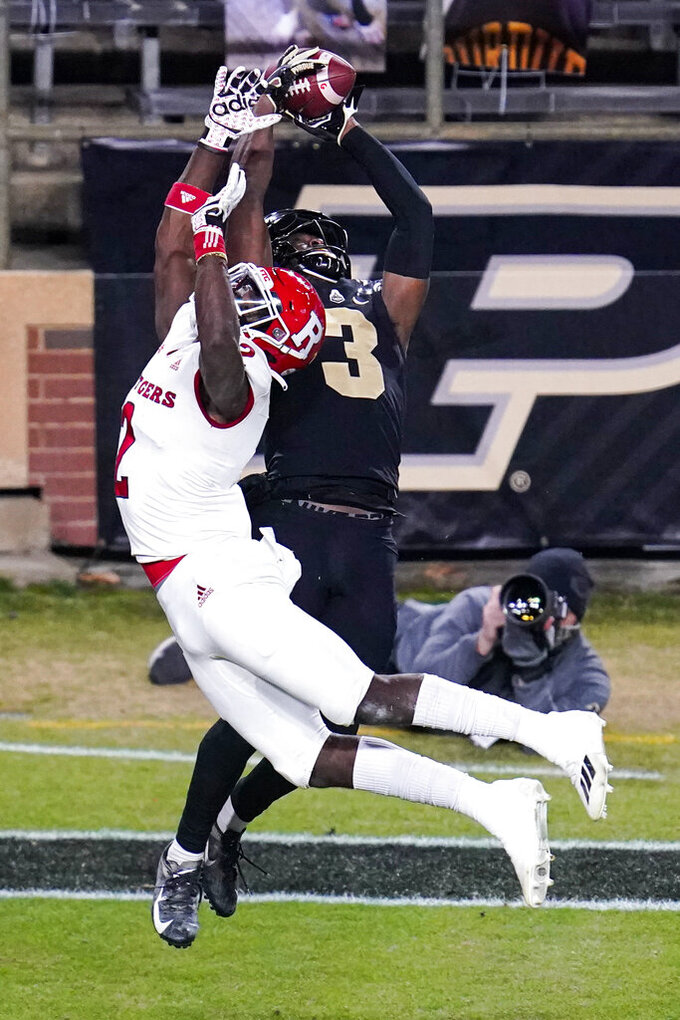Purdue wide receiver David Bell (3) makes a catch over Rutgers defensive back Avery Young (2) for a touchdown during the third quarter of an NCAA college football game in West Lafayette, Ind., Saturday, Nov. 28, 2020. (AP Photo/Michael Conroy)