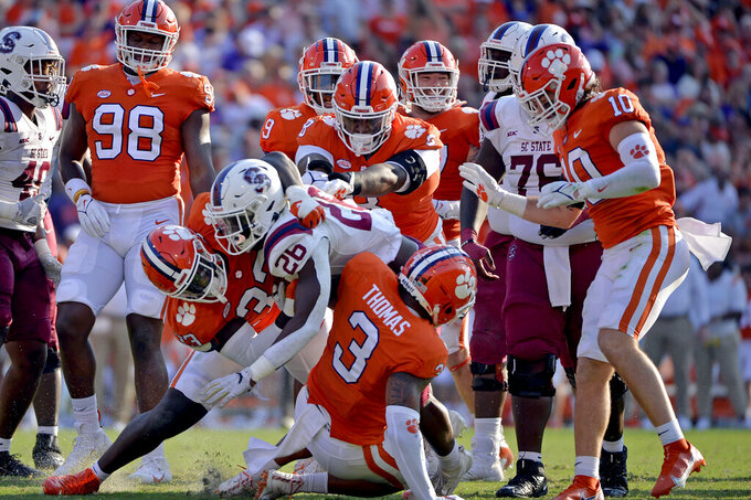 South Carolina State running back Kendrell Flowers (26) is tackled in the first half of an NCAA college football game against Clemson on Saturday, Sept. 11, 2021, in Clemson, S.C. (AP Photo/Edward M. Pio Roda)