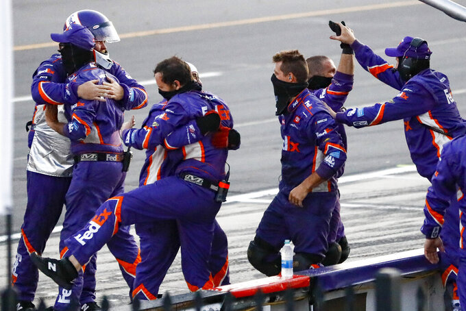 Crew members for Denny Hamlin celebrate Hamlin's win in the NASCAR Cup Series auto race at Pocono Raceway, Sunday, June 28, 2020, in Long Pond, Pa. (AP Photo/Matt Slocum)