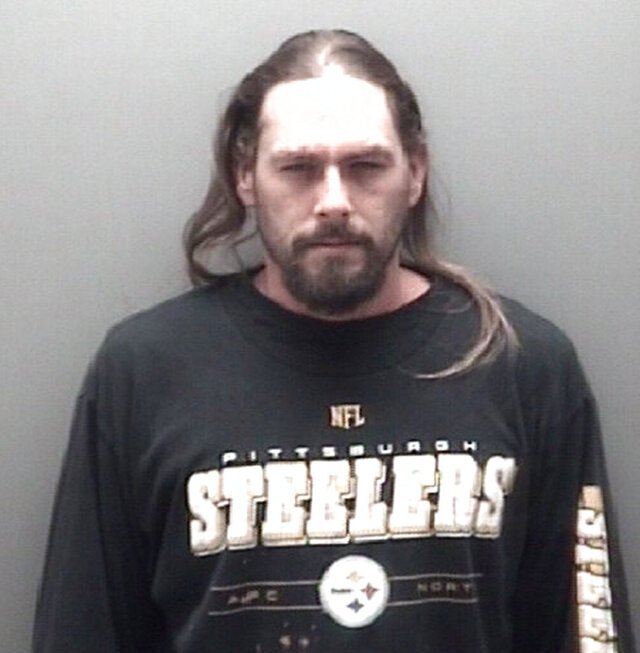 This photo provided by the Eaton County Sheriff's Department and released on April 17, 2109 shows Robert Carabello. Eaton County prosecutors say 35-year-old Caraballo was killed in Charlotte, where he lived, and his remains were found in a metal foot locker that had been set on fire and left in a wooded area of Ottawa County. Police in Rome say an American woman wanted in the 2002 death of her husband has been arrested in a Rome hotel. Rome police arrested Beverly McCallum after she checked in sat the hotel. Italian hotels are required to register guests in an online system linked to a police database. A police spokeswoman said that database flagged an international arrest warrant for McCallum's arrest. U.S. authorities had been seeking to extradite McCallum from Pakistan, where she was believed to be living, to stand trial in the slaying of her husband, Robert Caraballo. (Eaton County Sheriff's Department via AP)