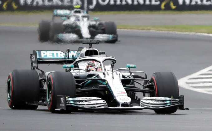 Mercedes driver Lewis Hamilton of Britain steers his car followed by Mercedes driver Valtteri Bottas of Finland during the third free practice at the Silverstone racetrack, in Silverstone, England, Saturday, July 13, 2019. The British Formula One Grand Prix will be held on Sunday. (AP Photo/Luca Bruno)