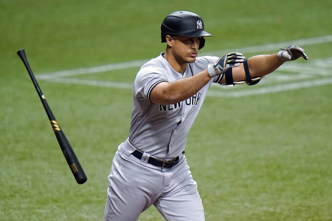 New York Yankees' Giancarlo Stanton reacts as he flies out to Tampa Bay Rays right fielder Brett Phillips during the third inning of a baseball game Thursday, May 13, 2021, in St. Petersburg, Fla. (AP Photo/Chris O'Meara)