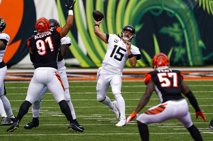 Jacksonville Jaguars quarterback Gardner Minshew (15) throws against the Cincinnati Bengals n the first half of an NFL football game in Cincinnati, Sunday, Oct. 4, 2020. (AP Photo/Bryan Woolston)