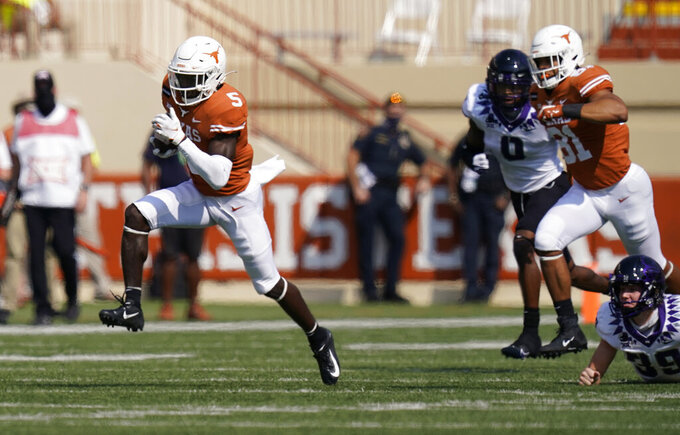 Texas running back Bijan Robinson (5) returns a kick against TCU during the first half of an NCAA college football game, Saturday, Oct. 3, 2020, in Austin, Texas. (AP Photo/Eric Gay)