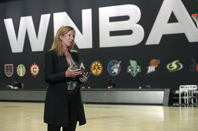 WNBA Commissioner Cathy Engelbert answers questions about a postponed game between the Seattle Storm and the Minnesota Lynx after Game 1 of a WNBA basketball semifinal round playoff game between the Connecticut Sun and the Las Vegas Aces, Sunday, Sept. 20, 2020, in Bradenton, Fla. (AP Photo/Phelan M. Ebenhack)