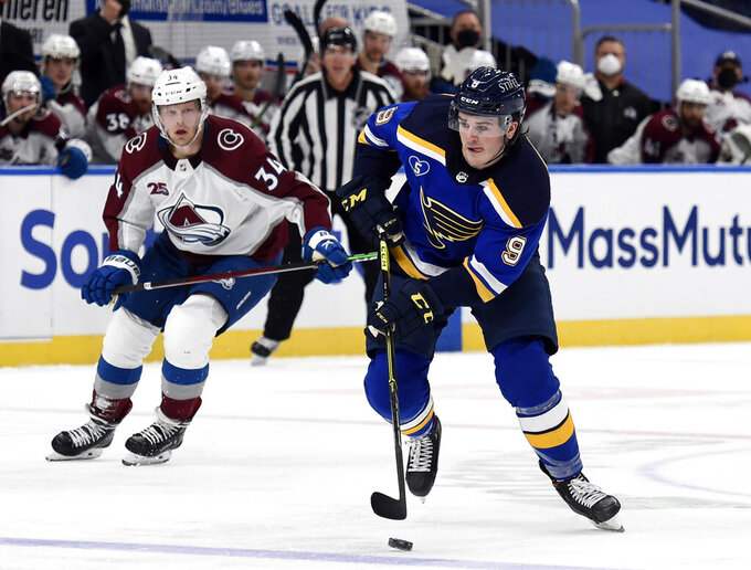FILE - In this April 14, 2021, file photo, St. Louis Blues' Sammy Blais (9) skates with the puck against the Colorado Avalanche during the second period of an NHL hockey game in St. Louis. The New York Rangers continued their offseason makeover Friday, July 23, 2021, by trading fourth-leading scorer Pavel Buchnevich to the Blues for Blais and a 2022 second-round pick. (AP Photo/Joe Puetz, File)