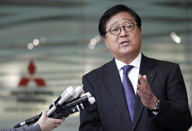 FILE - In this Jan. 18, 2019, file photo, Mitsubishi Motors CEO Osamu Masuko speaks during a press conference at its headquarters in Tokyo. Mitsubishi Motors Corp. reported Monday, July 27, 2020, a 176 billion yen ($1.7 billion) loss for April-June, and forecast more red ink for the fiscal year, as the coronavirus pandemic slammed auto demand around the world.  (AP Photo/Eugene Hoshiko)