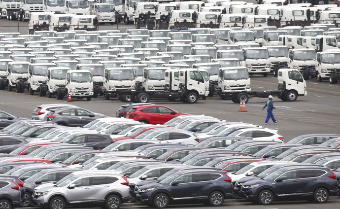 In this July 8, 2019, photo, Honda cars, foreground, for export park at Yokohama port, near of Tokyo in Tokyo. Japan's exports fell 12 percent in August from a year earlier as it logged a second straight month of deficits as the toll from trade tensions between its two largest markets deepened.(AP Photo/Koji Sasahara)