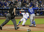 New York Mets' Amed Rosario (1) scores on a base hit by Juan Lagares as Toronto Blue Jays catcher Russell Martin (55) looks for the throw during the fourth inning of a baseball game Tuesday, May 15, 2018, in New York. (AP Photo/Julie Jacobson)