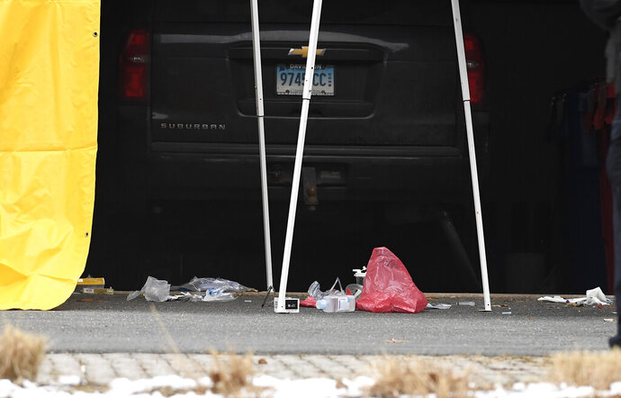 Medical supplies are seen outside an area outside of the garage to Fotus Dulos' home, Tuesday, Jan. 28, 2020, in Farmington, Conn.  A dispatcher from the Farmington police said officers had responded to Dulos' home and he was later transported to the hospital  (AP Photo/Jessica Hill)