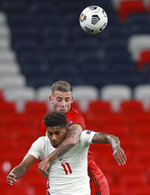 Belgium's Toby Alderweireld jumps above England's Marcus Rashford during the UEFA Nations League soccer match between England and Belgium at Wembley stadium in London, Sunday, Oct. 11, 2020. (AP Photo/Ian Walton, Pool)