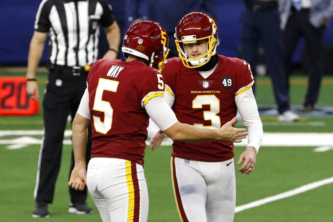 Washington Football Team's Tress Way (5) and Dustin Hopkins (3) celebrate after Hopkins kicked a field goal in the first half of an NFL football game against the Dallas Cowboys in Arlington, Texas, Thursday, Nov. 26, 2020. (AP Photo/Roger Steinman)