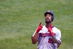 Minnesota Twins' Byron Buxton celebrates after hitting a home run during the fifth inning of a baseball game against the Milwaukee Brewers Wednesday, Aug. 12, 2020, in Milwaukee. (AP Photo/Morry Gash)