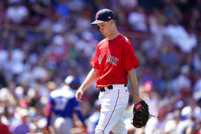 Boston Red Sox's Ryan Weber steps off the mound after giving up runs to the Toronto Blue Jays in the fourth inning of a baseball game, Sunday, June 13, 2021, in Boston. (AP Photo/Steven Senne)