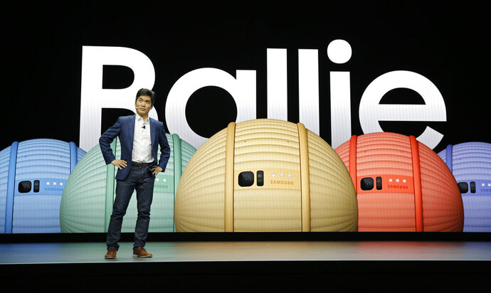 Sebastian Seung, executive vice president and chief research scientist of Samsung Research, talks about Ballie, an AI rolling robot during a Samsung keynote before the CES tech show, Monday, Jan. 6, 2020, in Las Vegas. (AP Photo/John Locher)