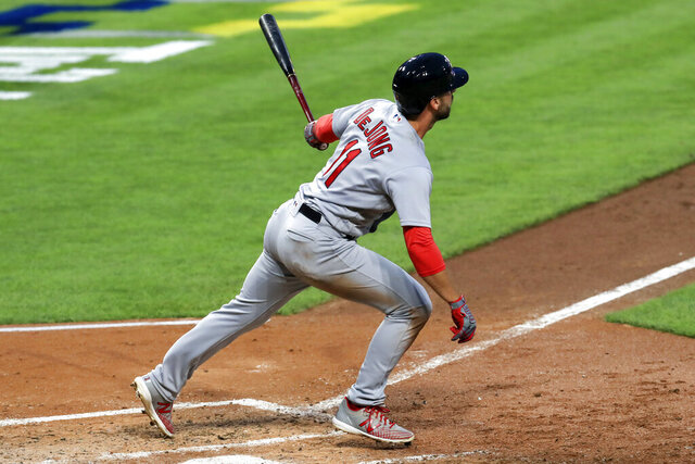 St. Louis Cardinals' Paul DeJong hits a grand slam in the fourth inning of a baseball game against the Cincinnati Reds in Cincinnati, Monday, Aug. 31, 2020. (AP Photo/Aaron Doster)