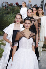 Model Kaia Gerber leads other models as they wear creations for the Chanel Haute Couture Spring/Summer 2020 fashion collection presented Tuesday Jan. 21, 2020 in Paris. (AP Photo/Francois Mori)