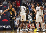 Wichita State's Dexter Dennis, left, reacts at the end of double overtime in an NCAA college basketball game against Connecticut, Sunday, Jan. 12, 2020, in Hartford, Conn. (AP Photo/Jessica Hill)