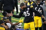 FILE  - In this Nov. 8, 2020, file photo, Pittsburgh Steelers' JuJu Smith-Schuster (19) and Eric Ebron (85) celebrate on the bench after Enron caught a touchdown pass late in the second half of an NFL football game against the Dallas Cowboys in Arlington, Texas. From the unbeaten Steelers at the top to the winless Jets at the bottom, predictability has taken a hike halfway through NFL 2020.  (AP Photo/Michael Ainsworth, File)