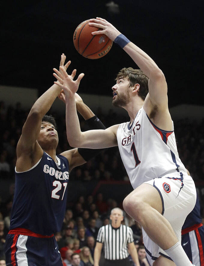 Saint Mary's center Jordan Hunter (1) shoots against Gonzaga forward Rui Hachimura during the second half of an NCAA college basketball game in Moraga, Calif., Saturday, March 2, 2019. (AP Photo/Jeff Chiu)