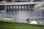 Rickie Fowler hits out of the bunker on the sixth hole during the first round of the U.S. Open Championship golf tournament Thursday, June 13, 2019, in Pebble Beach, Calif. Fowler finished the round at 5-under par, 66.(AP Photo/Marcio Jose Sanchez)