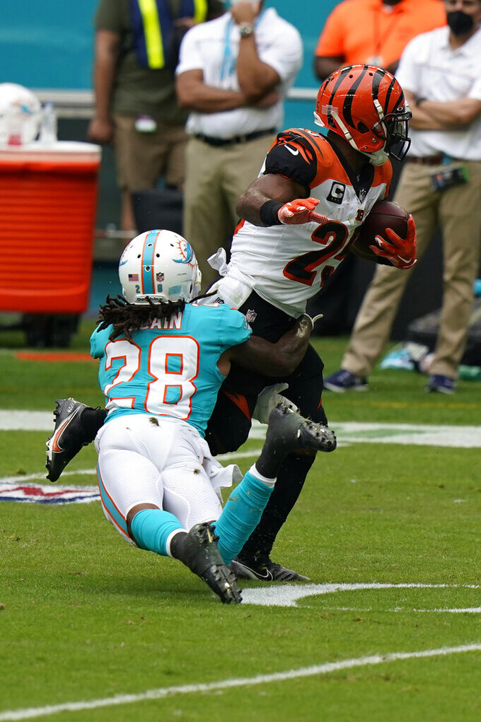 Miami Dolphins strong safety Bobby McCain (28) tackles Cincinnati Bengals running back Giovani Bernard (25), during the first half of an NFL football game, Sunday, Dec. 6, 2020, in Miami Gardens, Fla. (AP Photo/Lynne Sladky)
