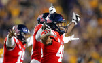 Mississippi players celebrate after a missed field goal by LSU during the first half of an NCAA college football game in Baton Rouge, La., Saturday, Sept. 29, 2018. (AP Photo/Gerald Herbert)