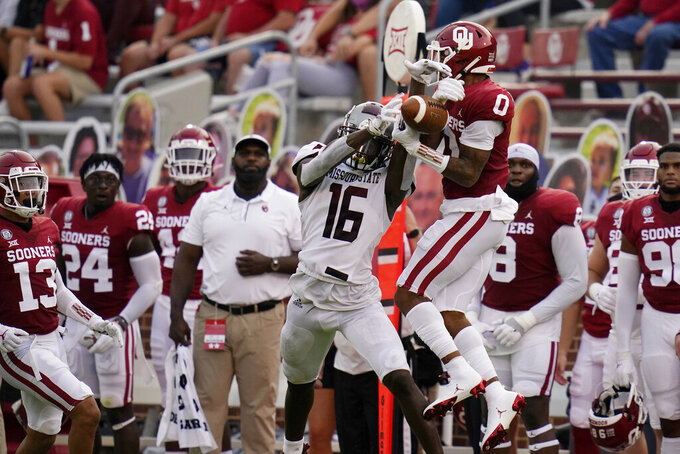 Oklahoma safety Woodi Washington (0) breaks up a pass intended for Missouri State wide receiver Damoriea Vick (16) in the first half of an NCAA college football game Saturday, Sept. 12, 2020, in Norman, Okla. (AP Photo/Sue Ogrocki, Pool)