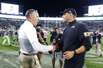 Michigan State coach Mark Dantonio, left, and Western Michigan coach Tim Lester shake hands following an NCAA college football game, Saturday, Sept. 7, 2019, in East Lansing, Mich. Michigan State won 51-17. (AP Photo/Al Goldis)