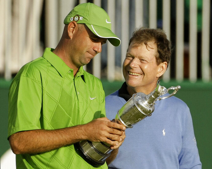 FILE - In this July 19, 2009, file photo, Stewart Cink of the United States, left, holds the trophy as compatriot Tom Watson looks on after Cink won the British Open Golf championship, in Turnberry, Scotland. Ten years ago, Watson was one putt away from winning the Open at age 59. (AP Photo/Matt Dunham, File)