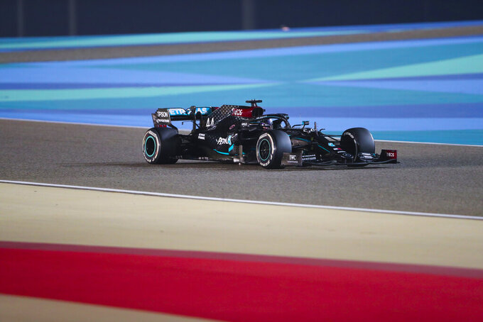 Mercedes driver Lewis Hamilton of Britain steers his car during the Formula One Bahrain Grand Prix in Sakhir, Bahrain, Sunday, Nov. 29, 2020. (AP Photo/Kamran Jebreili, Pool)
