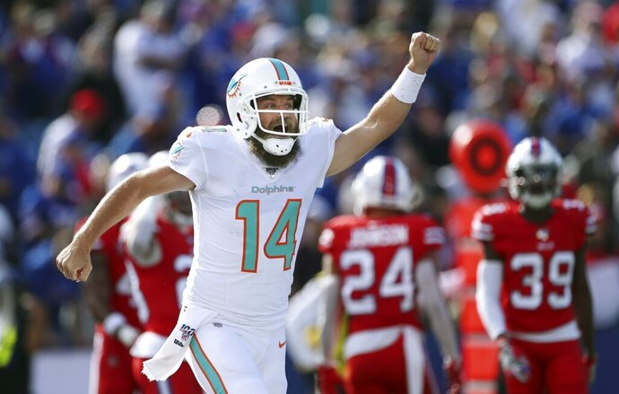 Miami Dolphins quarterback Ryan Fitzpatrick celebrates his touchdown pass to DeVante Parker in the first half of an NFL football game against the Buffalo Bills, Sunday, Oct. 20, 2019, in Orchard Park, N.Y. (AP Photo/Ron Schwane)