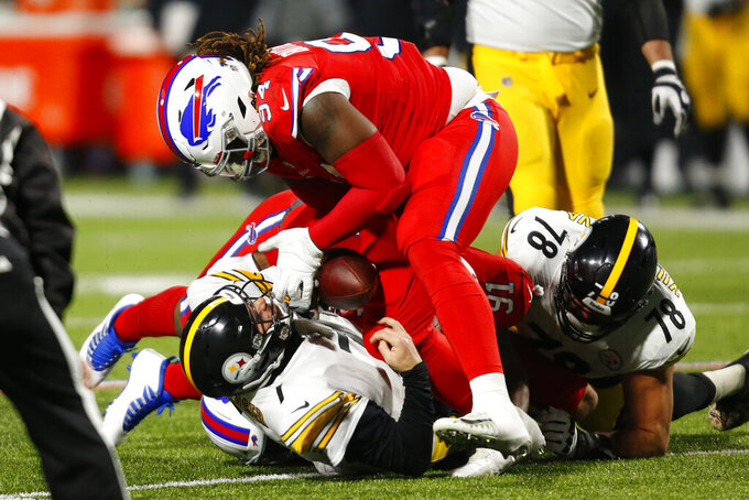Pittsburgh Steelers quarterback Ben Roethlisberger (7) fumbles the ball as he is sacked by Buffalo Bills defensive tackle Ed Oliver (91) and Vernon Butler (94) during the second half of an NFL football game in Orchard Park, N.Y., Sunday, Dec. 13, 2020. The Bills recovered the ball. (AP Photo/Jeffrey T. Barnes )