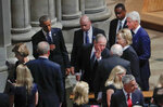 FILE - In this Sept. 1, 2018, file photo former President George W. Bush, center, leans in to talk to former Vice President Dick Cheney, as he walks out with from left, former first lady Laura Bush, former President Barack Obama, former Secretary of State Hillary Clinton and former President Bill Clinton, after attending the memorial service for Sen. John McCain, R-Ariz., at Washington National Cathedral in Washington. (AP Photo/Pablo Martinez Monsivais, File)