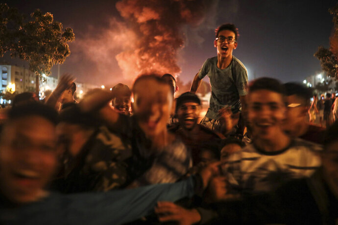 In this Monday, Sept. 9, 2019 photo, youths react during the celebration of Ashura, in Sale, near Rabat, Morocco. On Sept. 9, the Arab and Muslim world marked Ashura, a day commemorating the death of Imam Hussein, the grandson of the Prophet Muhammad and one of Shia Islam's most important figures. (AP Photo/Mosa'ab Elshamy)