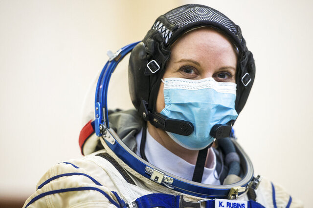 This photo provided by NASA. Expedition 64 crew member NASA astronaut Kate Rubins, is seen during Soyuz qualification exams Wednesday, Sept. 23, 2020 at the Gagarin Cosmonaut Training Center (GCTC) in Star City, Russia. Rubins told The Associated Press on Friday, Sept. 25 that she plans to cast her next vote from space – more than 200 miles above Earth. Rubins and two Russian cosmonauts are preparing for a mid-October launch to the International Space Station, where she'll spend the next six months.  (Andrey Shelepin/GCTC/NASA via AP)