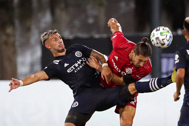 New York City FC midfielder Valentin Castellanos battles against Toronto FC defender Omar Gonzalez, right, during the second half of an MLS soccer match, Sunday, July 26, 2020, in Kissimmee, Fla. (AP Photo/John Raoux)