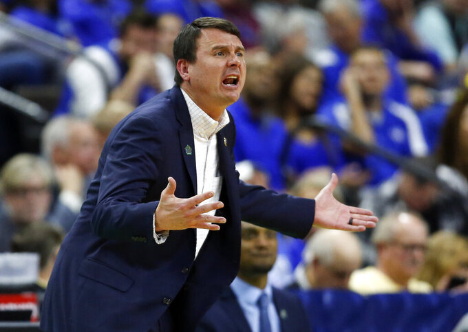 Abilene Christian coach Joe Golding shouts during the first half against Kentucky in a first-round game in the NCAA men's college basketball tournament in Jacksonville, Fla., Thursday, March 21, 2019. (AP Photo/Stephen B. Morton)