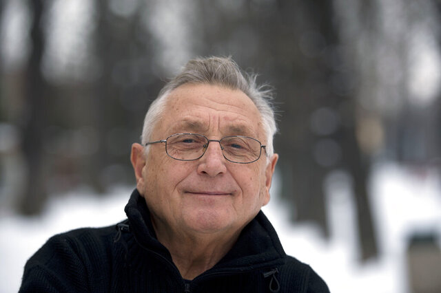 FILE - in this Feb. 13, 2013 file photo Czech Oscar-winning film director Jiri Menzel iposes for the photographer. in Prague, Czech Republic. Menzel died on Saturday, Sept. 5, 2020 aged 82. (Michal Dolezal/CTK via AP)