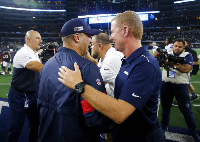 Houston Texans head coach Bill O'Brien, left, and Dallas Cowboys head coach Jason Garrett, right, greet each other after their preseason NFL football game in Arlington, Texas, Saturday, Aug. 24, 2019. (AP Photo/Michael Ainsworth)