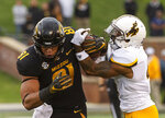 Missouri tight end Albert Okwuegbunam, left, has the ball ripped from his hands by Wyoming cornerback Antonio Hull, right, during, right, for a turnover the first half of an NCAA college football game Saturday, Sept. 8, 2018, in Columbia, Mo. (AP Photo/L.G. Patterson)