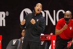North Carolina State coach Kevin Keatts yells to his players during the first half against Charleston Southern in an NCAA college basketball game in Raleigh, N.C., Wednesday, Nov. 25, 2020. (Ethan Hyman/The News & Observer via AP)