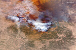 This satellite image provided courtesy of Maxar Technologies shows the natural color overview of the Lame Deer and Richard Spring wildfire in Montana on Friday, Aug. 13, 2021. Maxar collected new high-resolution satellite imagery Aug. 13th of the two wildfires burning in southeastern Montana near the evacuated town of Lame Deer. (Satellite Image ©2021 Maxar Technologies via AP)