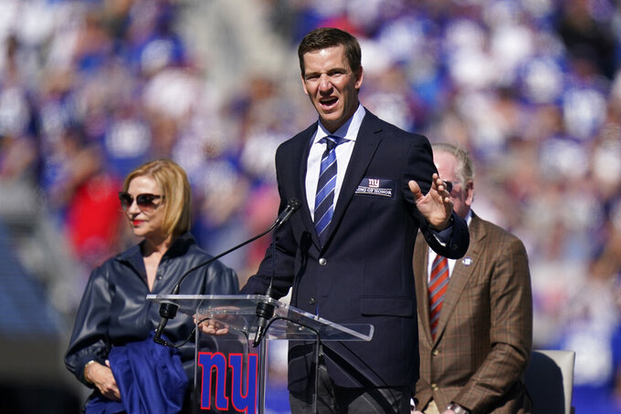 Former New York Giants quarterback Eli Manning addresses the crowd during a ceremony to retire his jersey number 10 and honor his tenure with the team during half-time in an NFL football game against the Atlanta Falcons, Sunday, Sept. 26, 2021, in East Rutherford, N.J. (AP Photo/Seth Wenig)