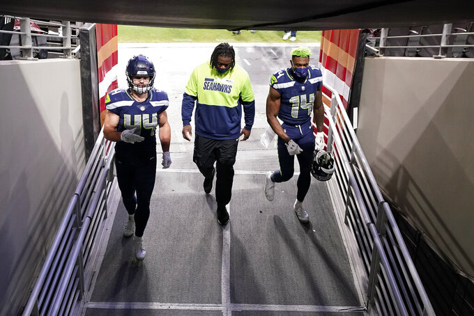 Seattle Seahawks punter Michael Dickson (4) and fullback Nick Bellore (44) after an NFL football game against the San Francisco 49ers, Sunday, Jan. 3, 2021, in Glendale, Ariz. The Seahawks won 26-23. (AP Photo/Ross D. Franklin)